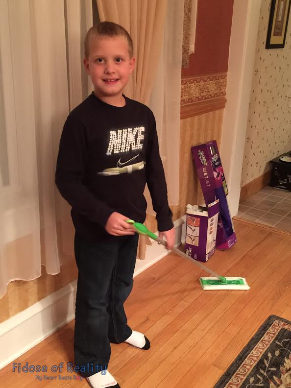 Ryan helps out with the Swiffer tool because #ShedHappens