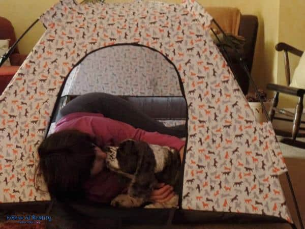 Cuddle with dog in tent