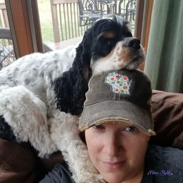 cocker spaniel cuddles with mom